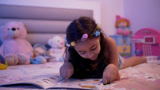 Cute little child girl doing homework and reading a book - Education and smart learning concept