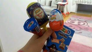 Berat Buğra kinder joy ozmo çikolataların tadına bakıyor toybox lolipopta varmış.