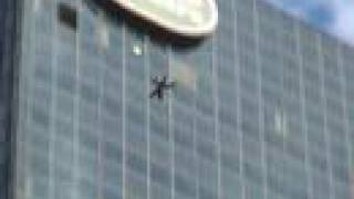 Guy Jumps Through High Rise Window !!!