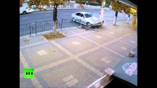 CCTV: Boy steps aside seconds before car slams into same place