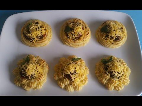 وجبة-غذاء-او-عشاااء-بالبطاطس-بشكل-جديييد-شهيييية-و-لذيييذة-/nid-de-pomme-de-terre
