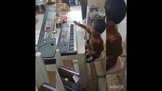 my kid learning piano