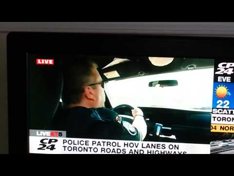 PanAm GamesTemporary Hov Lane,  Officer distracted while being interviewed