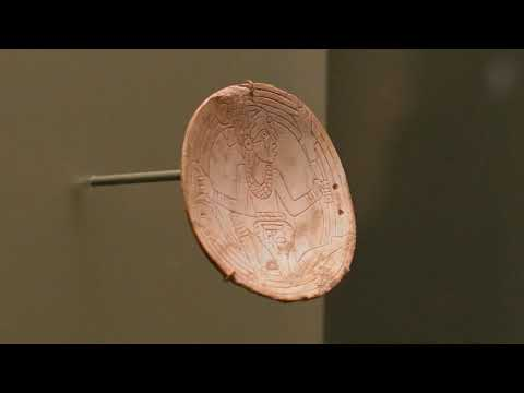 Mississippian shell neck ornament (gorget)