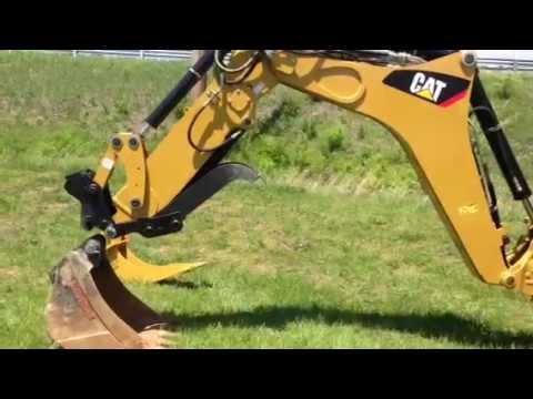Cat 420E quick attach w/ thumb