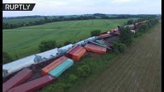 Drone footage: Train derails in Canada, 2 carriages with propane fall into river