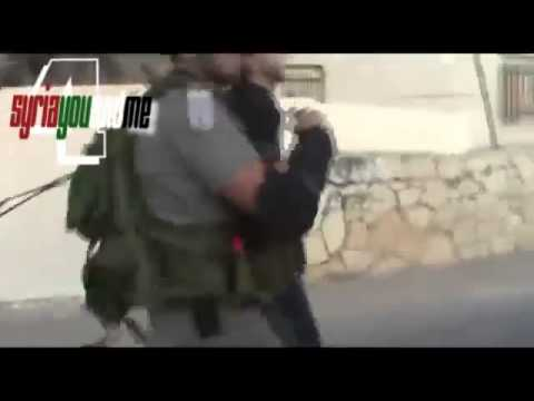 Israeli Soldier pepper Spray attack on Palestinian Mother trying to save her Son