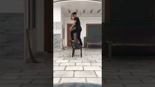 Guy Steps on Chair While Dancing and Breaks Backrest - 1066040-2