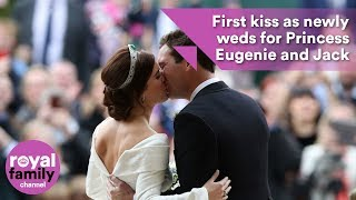 Princess Eugenie and Jack Brooksbank kiss on steps after wedding ceremony