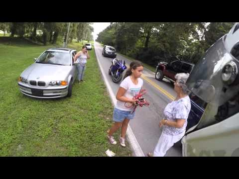 Biker directs traffic during accident