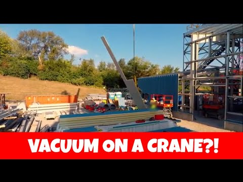 Using a crane and vacuum lifter to set insulated metal panels