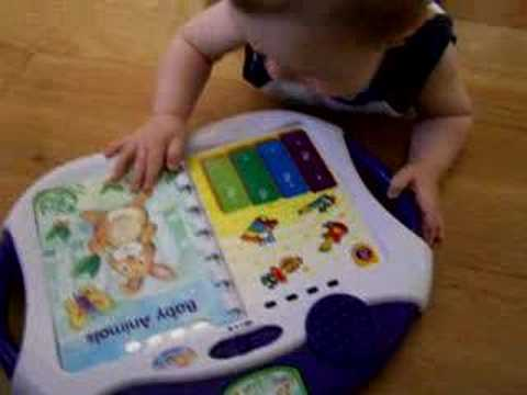 Matthew Playing With His Fisher Price Book