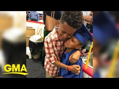 image for Brother and sister embracing at preschool graduation has hearts exploding