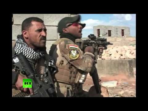 Iraqi troops backed by US-led airstrikes fired at ISIS militants in a neighbourhood of Ramadi