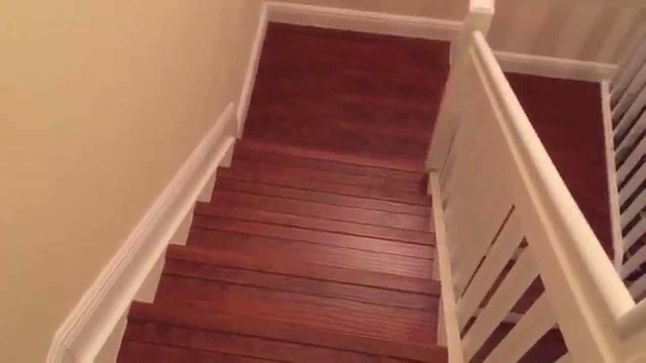 Installing Laminate Wood Flooring Staircase With White Riser YouTube