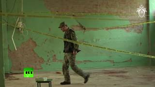 Следователи работают на месте трагедии в керченском колледже