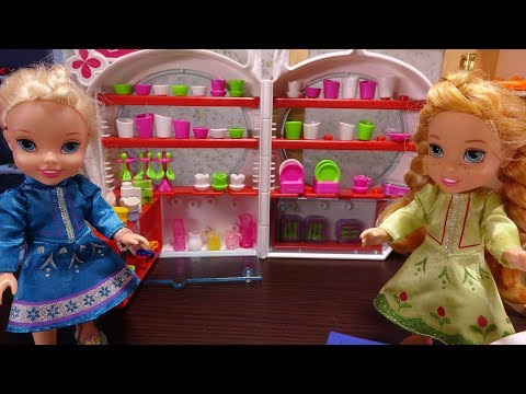 Elsa and Anna toddlers at the shop with My little Pony and Barbie
