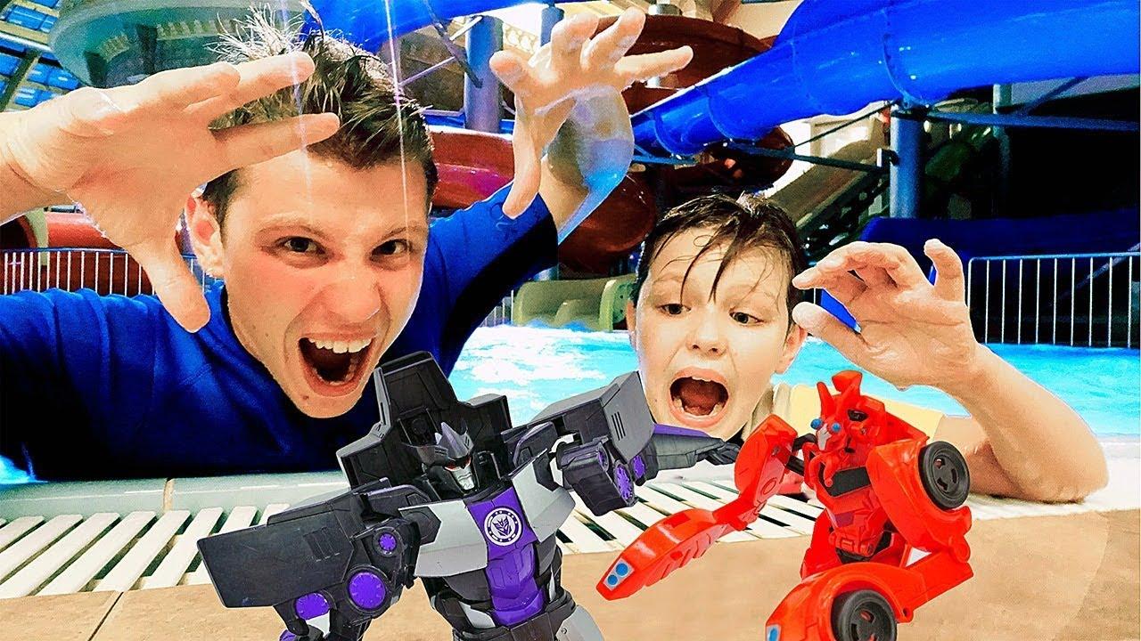 Роботы Трансформеры – Игры в аквапарке - Десептиконы против Автоботов!