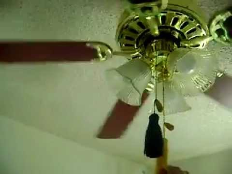 Heritage Lancaster Ceiling Fan With The Tassles On It