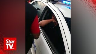 Negri police arrest two men for allegedly stopping, inspecting police car
