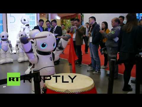 Robo-fish and artistic androids on display at World Robot Conference in China