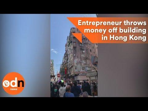Entrepreneur throws pile of cash off a building in Hong Kong