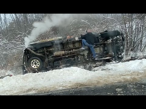 Video shows man rush to rescue driver trapped after rollover crash on Maine road