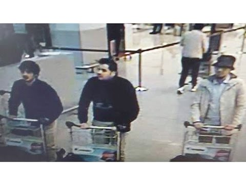 Manhunt is underway for the third Brussels bombing suspect pictured on airport surveillance footage
