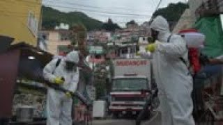 Brothers Campaign To Curb Virus In Brazil Favela