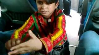 Little Indian Boy Entertains in Bus