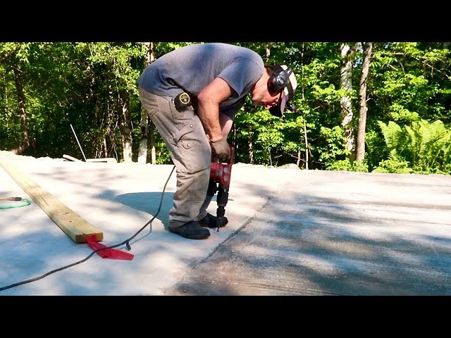 Drilling 41 HOLES in our $3000 Concrete Slab (Post and Beam Barn Build day #12)
