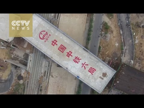 Chinese engineers build 7,500-ton flyover section above high-speed railway