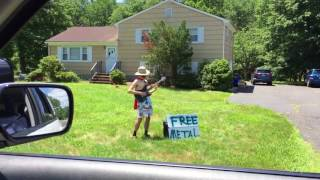 Shirtless electric guitarist plays free concert in front of home
