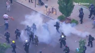 Peaceful protesters dispersed with tear gas moments before President Trump walks to church burne...
