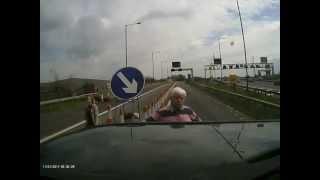 idiot caravan driver thinks indicating stops moving traffic