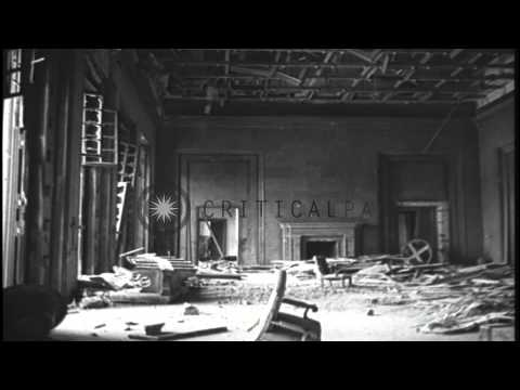 Damaged furniture and chandeliers at German Chancellery after the Allied bombings...HD Stock Footage