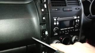 How to remove the  radio from a  Suzuki Grand Vitara