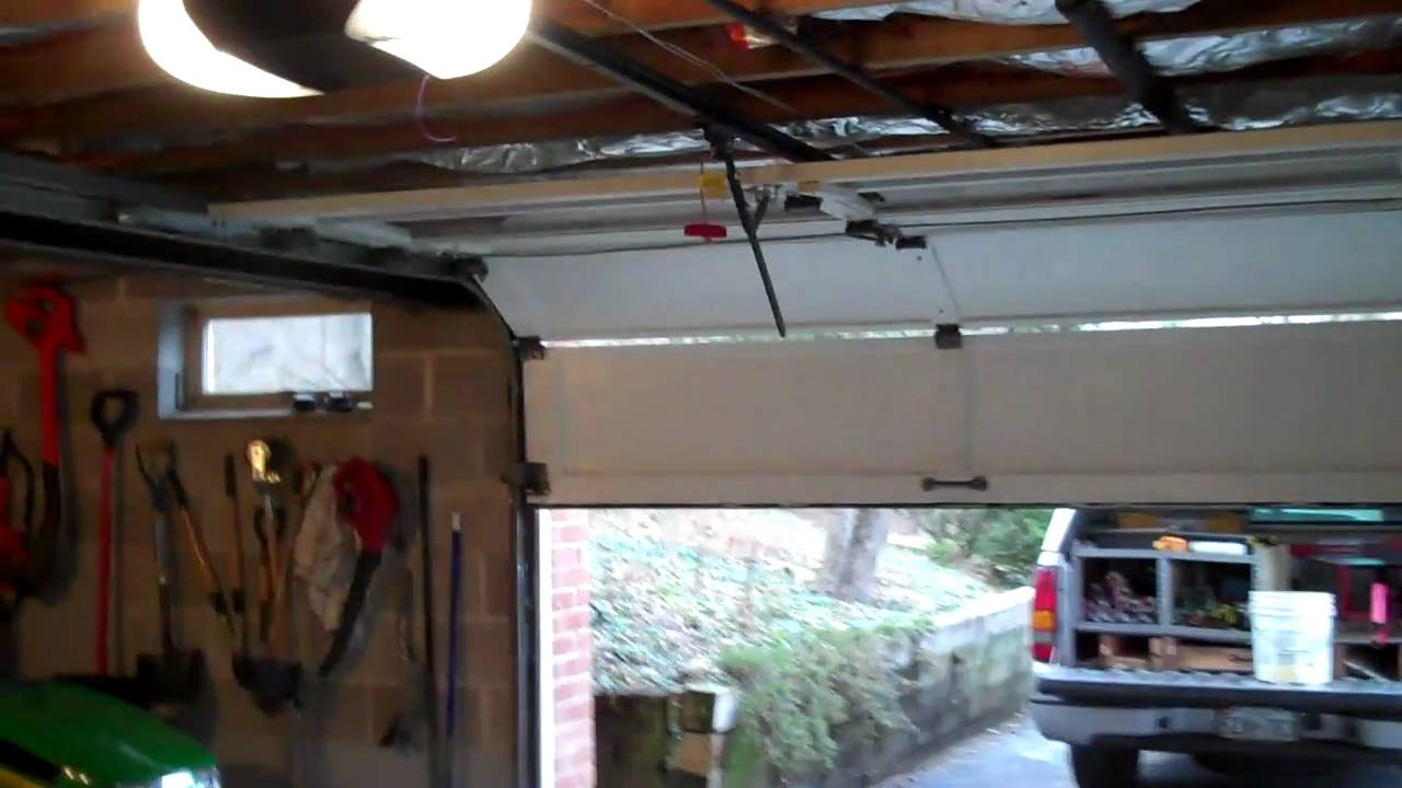 Garage Opener with Tricked Hinges for a 65 cut down Door  YouTube