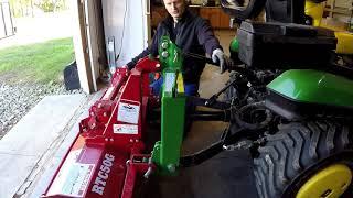 John Deere 1025R Using new roto tiller to cut in huge gravel driveway