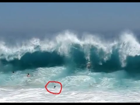 TOURISTS SLAMMED BY MASSIVE WAVES