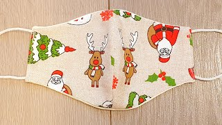 Christmas face mask with Santa Claus christmas tree and reindeer