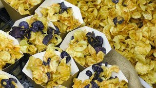 Cutting and Cooking Fried Twisted Chips. Italian Street Food