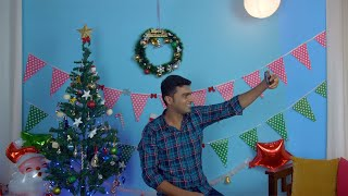 Handsome Indian man having fun while clicking pictures on Christmas Eve - winter season