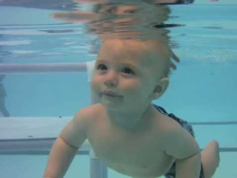 Infant Swimming Underwater for the First Time