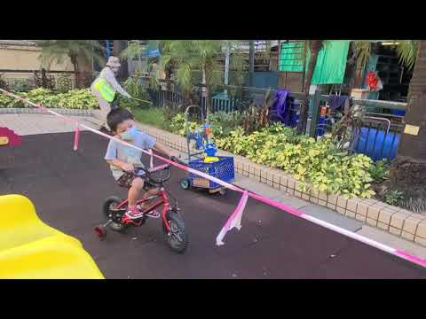 First time riding bicycle in park thumbnail
