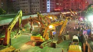 видео: 100 Plus Excavators Dismantle Overpass Bridge in East China