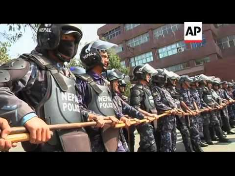 Hundreds of Tibetan protesters clash with police after anti-China protest