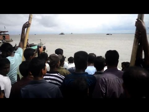 Bangladeshis mourn missing relatives after overloaded ferry sinks