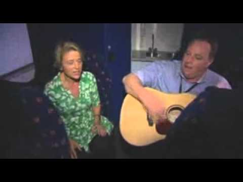 NSW premier Kristina Keneally and Mark Tobin sing