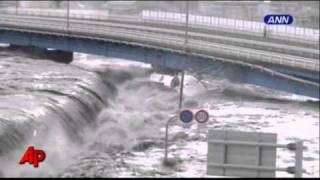 Raw Video: Tsunami Wave Smashes Boats and Cars
